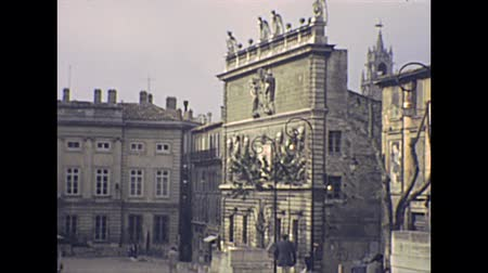 super car : AVIGNON, FRANCE - CIRCA 1970: Hotel des Monnaies in Place du Palais square. Archival of Avignon town of France in 1970s. Stock Footage
