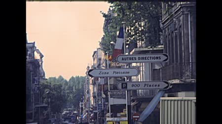 super car : AVIGNON, FRANCE - CIRCA 1970: alleys and streets with vintage cars in the traffic and people in vintage dress. Archival of Avignon town of France in 1970s. Stock Footage