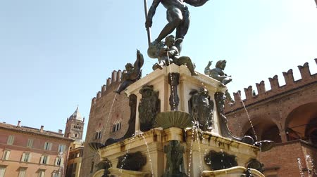 bolognai : Bologna, Italy - June 24, 2019: medieval architecture of Bologna. Neptune statue and restored fountain. Perspective view from bottom.