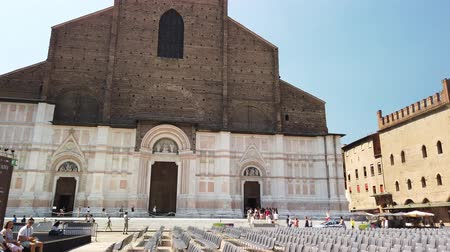 bolognai : Bologna, Italy - June 24, 2019: Bologna city, and Balisica of San Petronio on the Piazza Maggiore, the largest church built in bricks in the world.