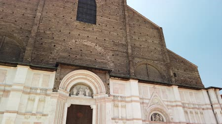piazza : Bologna, Italy - June 24, 2019: facade of Balisica of San Petronio on the Piazza Maggiore, the largest church built in bricks in the world. Stock Footage