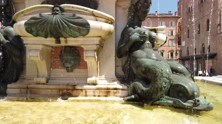 nettuno : Bologna, Italy - June 24, 2019: Neptune 1500s bronze fountain close up on mermaid. located in Piazza Maggiore central square.