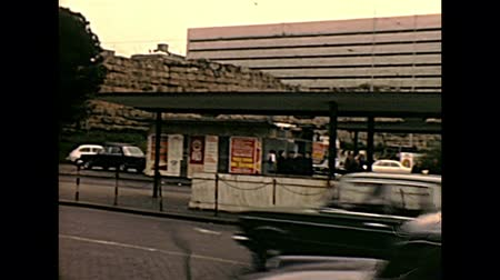 pałac : ROME, ITALY - CIRCA 1970: The car traffic in front of Termini station in Piazza dei Cinquecento square of Rome. Historical archival of Rome capital of Italy in the 1970s.