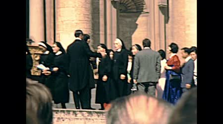 paus : VATICAN, ROME, ITALY - CIRCA 1970: Japanese delegation in Basilica of Saint Peter waiting to meet the old Pope Saint Paul VI with Swiss Guard. Historical Archival of Rome capital of Italy in the 1970s Stockvideo