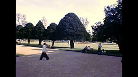richmond park : Molesey, UNITED KINGDOM - CIRCA 1970: people in Great Fountain Garden, the courtyard of Hampton Court Palace, the royal palace in East Molesey town, close London city. Archival in 1970s in England.