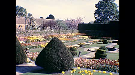 Molesey, UNITED KINGDOM - CIRCA 1970: sunken garden with William IIIs Banqueting House in Hampton Court Palace. Royal palace in East Molesey town, beside London city. Archival in 1970s in England.