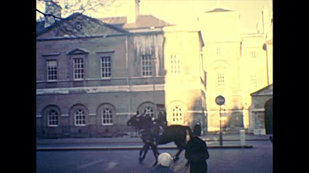 Molesey, UNITED KINGDOM - CIRCA 1970: horse parade at Hampton Court Palace gate, a royal palace in town of East Molesey, Richmond upon Thames, beside London city. Archival in 1970s in England. Стоковые видеозаписи