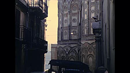 sycylia : Monreale, Sicily, ITALY - CIRCA 1960: view of Cathedral of Monreale, from road Via Arcivescovado of town Monreale of Sicily in Italy. Historical archival of Palermo province of Italy in the 1960s.