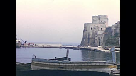 sycylia : Castellammare del Golfo, Sicily, ITALY - CIRCA 1960: Panorama with boats of the rural seascape of Castellammare of Sicily in Italy. Historical archival of Castellammare town of Italy in the 1960s.