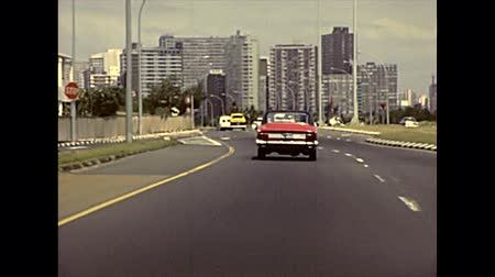 super car : DURBAN, South Africa - circa 1981: vintage cars driving on the highway to Durban in city. Historical archival footage in Durban city of 1980s in South Africa. Stock Footage
