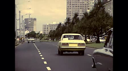 super car : DURBAN, South Africa - circa 1981: street view with vintage cars and vintage bus on the Durban downtown traffic. Historical archival footage in Durban city of 1980s in South Africa. Stock Footage
