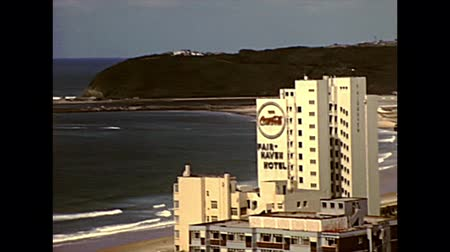 natal : DURBAN, South Africa - circa 1981: Top panorama of the waterfront of Durban with skyscrapers and old lighthouse. Historical archival footage in Durban harbor of the 1980s in South Africa. Stock Footage