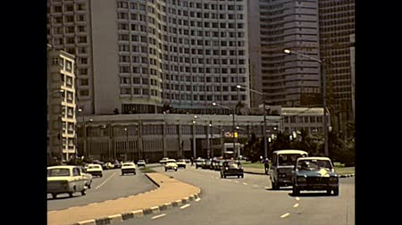 super car : DURBAN, South Africa - circa 1981: vintage cars and vans on the streets of Durban downtown. Historical archival footage in Durban city of 1980s in South Africa.