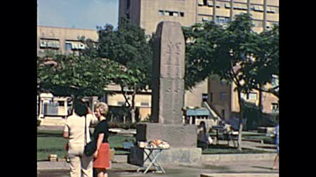obelisk : CAIRO, EGYPT, AFRICA - circa 1973: East side of the Obelisk of Ramses II with tourists visiting in the Egyptian Museum of Cairo city. Historical archival of Cairo capital city of Egypt in 1970s.