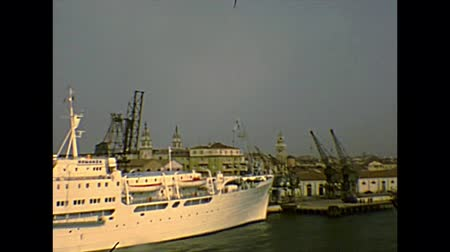 docked : Venice, Italy - circa 1980: big cruise ships docked in Venezia harbor of Giudecca canal. Archival of Venezia city of Italy in the 1980s, Venetian lagoon. Stock Footage