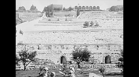 yahudi : JERUSALEM, ISRAEL - CIRCA 1979: Kidron Valley panorama with the Dominus Flevit Church from Olives Mount and city wall. Historic archival footage of Israel in the 1970s. Stok Video