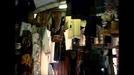 ha : JERUSALEM, ISRAEL - CIRCA 1979: old fashion dress, in ancient street market of the Muristan Christian Quarter. Archival footage of Israel in the 1970s.