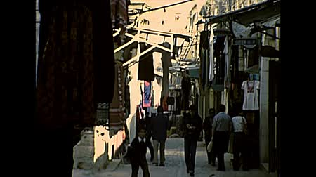 isteni : JERUSALEM, ISRAEL - CIRCA 1979: road market with jewish people in Keffiyeh, the traditional Arab headdress worn by Palestinian men. Old city of Jerusalem archival in 1970s in Israel.