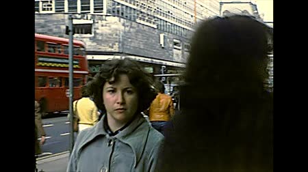 archief : LONDON, UNITED KINGDOM - CIRCA 1977: people in Soho shopping area of Westminster city, between Oxford Street and Regent Street. Archival of London in 1970s.
