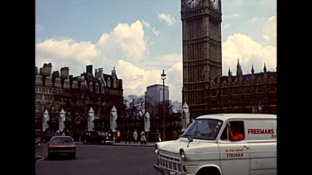 big ben : LONDON, UNITED KINGDOM - CIRCA 1977: Big Ben clock tower in Parliament Square with flags of Europe and the United Kingdom. Archival of London city of England 1970s