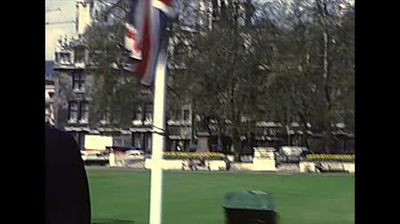 westminster : LONDON, UNITED KINGDOM - CIRCA 1977: Parliament Square with flags of Europe and the United Kingdom. Central Hall Westminster building. Archival of London city of England in the 1970s.