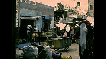 パレスチナ : BETHLEHEM, WEST BANK, ISRAEL- CIRCA 1979: Streets life with local people in Palestinian dress, working and shopping in the markets and shops on the road. Historic Israel and Palestine in the 1970s.