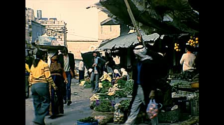 west bank : BETHLEHEM, WEST BANK, ISRAEL- CIRCA 1979: Palestinian women shopping in local food markets. During the occupation of Israel until 1995. Stock Footage