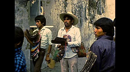 pielgrzymka : CUERNAVACA, MEXICO - circa 1970: Mexican vendors on the street by the Church of Nuestra Senora de Guadalupe or Our Lady of Guadalupe. Bell tower and dome. Archival of Mexico in South America in 1970s.