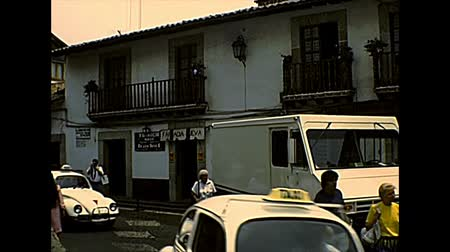 super car : TAXCO DE ALARCON, MEXICO - circa 1970: Taxco downtown roads, with Volkswagen beetles taxi and old cars. Archival of Mexico in South America in 1970s.