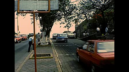 super car : CUERNAVACA, MEXICO - circa 1970: city downtown roads, Blvd. Lic. Benito Juarez to Carlos Pachecho 1894 monument. Cars with a traffic warden. Archival of Mexico in South America in 1970s.