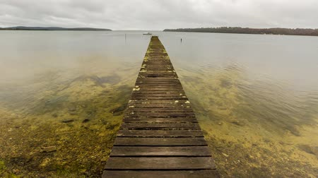 tasmania : Mystic cloudy landscape and wooden jetty in Georges Bay, St Helens, the most important city on the East Coast, Tasmania, Australia. Concept of simplicity, purpose, direction and infinity. Cinemagraph Stock Footage