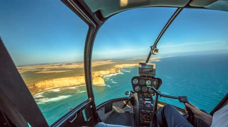 campbell : helicopter cockpit cinemagraph, during scenic flight over the Great Ocean Road in Victoria, Australia in the Port Campbell National Park flying over the Twelve Apostles and the shipwreck coast