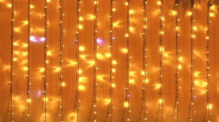 biesiada : golden lights background with Christmas lights in yellow and orange colors. Copy space Wideo