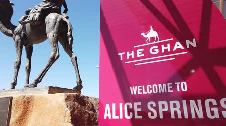 legendary : Alice Springs, Northern Territory, Australia - Aug 29, 2019: details of The Ghan Memorial: statue of Afghan worker and camel in Alice Springs Train Station. Sunny day in the blue sky.