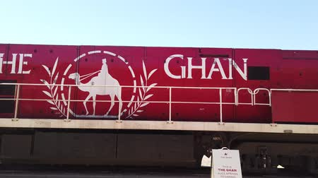 legendary : Alice Springs, Northern Territory, Australia - Aug 29, 2019: The legendary Ghan train stops at Alice Springs station on the Adelaide-Darwin route. Detail of red locomotive. Stock Footage