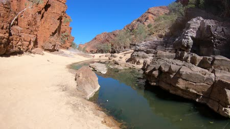 west macdonnell national park : Aerial view of rugged rocky cliffs of Ormiston Gorge in West MacDonnell Range National Park reflected in a pool on the river in dry season. Northern Territory, Central Australia, Outback Red Centre.