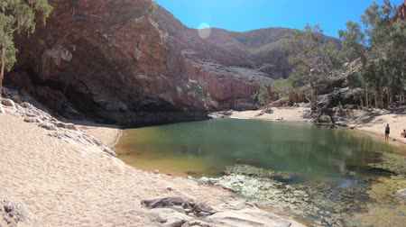 west macdonnell national park : Landscape of Ormiston Gorge Water Hole with ghost gum in West MacDonnell Ranges, Northern Territory, Australia. Ormiston Gorge is a popular area to swim or see the red high walls of gorge and pound.