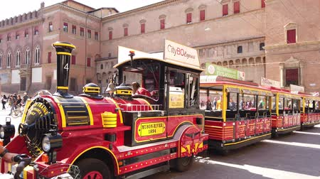 bolognai : Bologna, Italy - September 21, 2019: Tourist train at side of Piazza Maggiore square. San Luca Espress is the tourist line which connects the historic center with Basilica of San Luca.