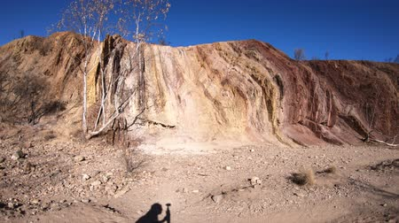 west macdonnell national park : Ochre Pits in dry river creek is a colorful rock formation of minerals ochre in West McDonnell Ranges National Park. Aboriginal sacred site in Northern Territory, Central Australia. Stock Footage