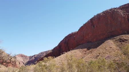 australian landscape : Dry Ormiston Gorge with red cliffs in West MacDonnell Ranges in Northern Territory, Central Australia Outback. Ormiston Pound walk is a popular circular walk trekking.