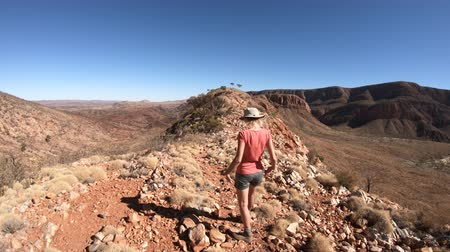 west macdonnell national park : Carefree woman enjoying with open arms on Mount Sonder top, one of highest Northern Territory mountain in Australian Outback. Ormiston Gorge during hiking Ormiston Pound Walk in West MacDonnell Ranges