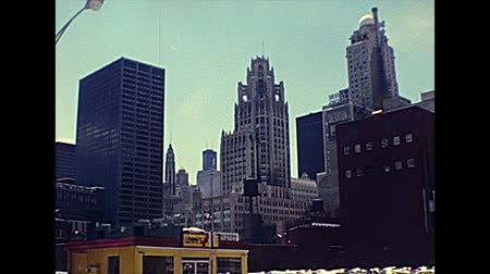 미드 타운 : Chicago, Lake Michigan, Illinois, United States - Circa 1977: Chicago downtown skyline in the 70s, at the ground level street view with old shops. The historical United States of America. 무비클립