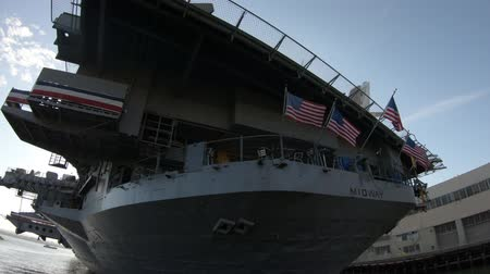 cold war : San Diego, Navy Pier, California, USA - JULY 31, 2018: USS Midway Battleship museumin San Diego California, Navy Pier of United States. National historic patriotic landmark. Stock Footage