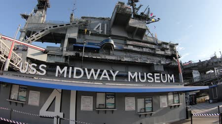 cold war : San Diego, Navy Pier, California, USA - JULY 31, 2018: American flags at USS Midway Warship museum in San Diego California, Navy Pier of United States. National historic patriotic landmark.