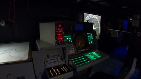 sala controllo : San Diego, Navy Pier, California, USA - JULY 31, 2018: dark war room with battle stations and instruments, consoles of Battleship Midway at San Diego. Popular tourist attraction in the city.
