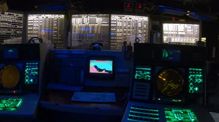 cold war : San Diego, Navy Pier, California, USA - JULY 31, 2018: Combat information center radar console, maps of Battleship Midway at San Diego, Navy Historic museum. Dark mode for combat operations.