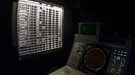 cold war : San Diego, Navy Pier, California, USA - JULY 31, 2018: operations room with lights on instruments, consoles, maps and radars of Battleship Midway at San Diego, National Historic Landmark.