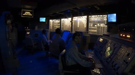 navy pier : San Diego, Navy Pier, California, USA - JULY 31, 2018: soldier operators of detection and tracking room of the Battleship USS Midway at San Diego, Navy Historic museum. Dark mode with radar and sonar.