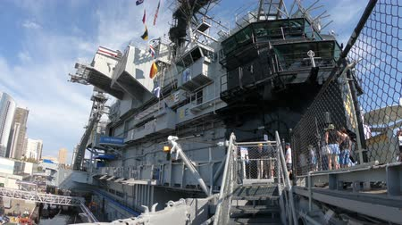 cold war : San Diego, Navy Pier, California, USA - August 1, 2018: entrance of USS Midway Battleship in San Diego California. Navy Pier of United States. National historic patriotic monument.