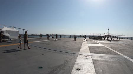 cold war : San Diego, Navy Pier, California, USA - August 1, 2018: The flight deck of USS Midway, a cold war warship at San Diego base. It was the longest-serving aircraft carrier of United States. Stock Footage